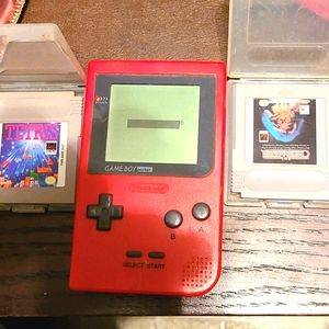 Vintage pocket held game boy with two games